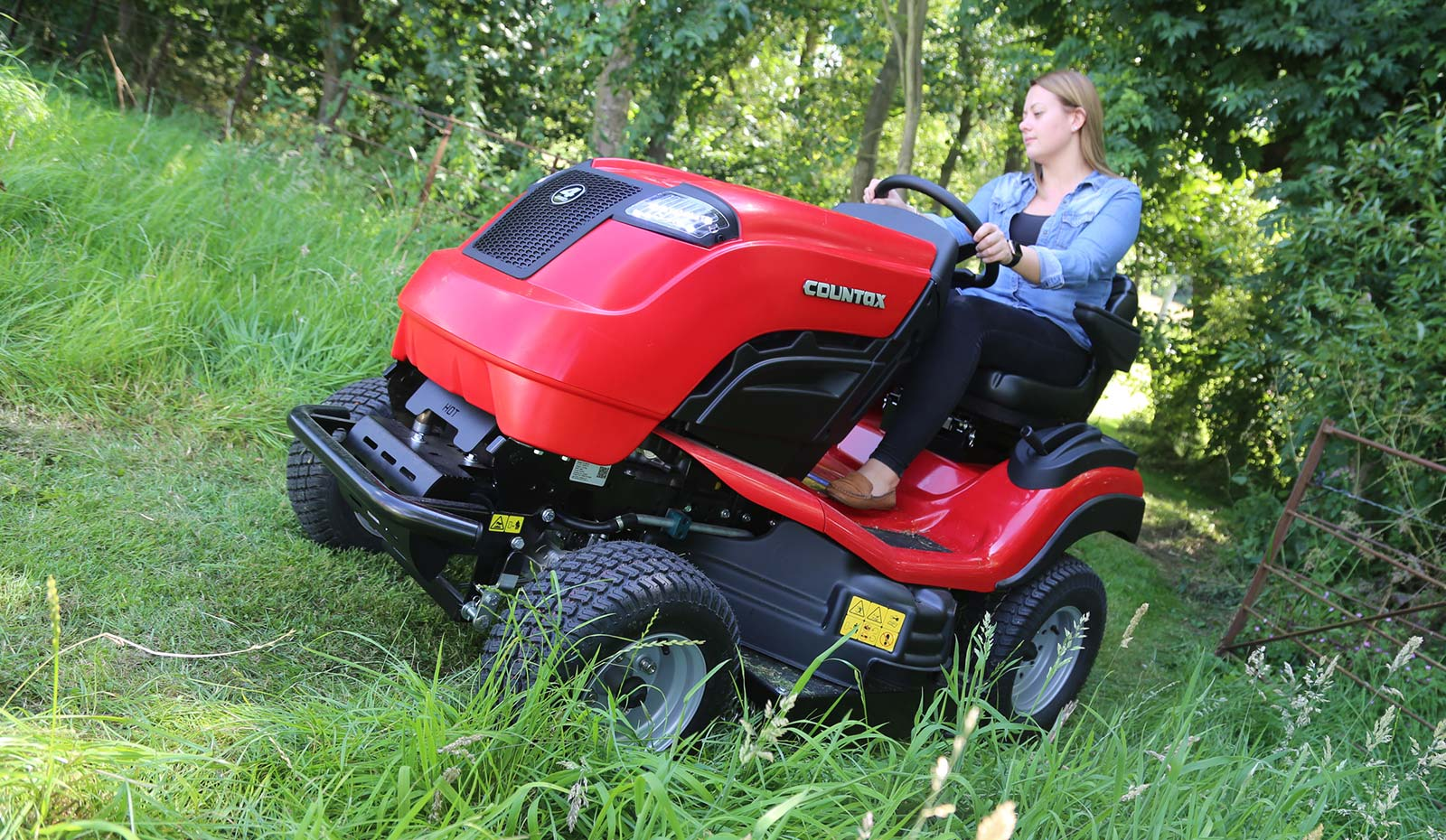 Countax B Series 4WD garden tractor ride on mower with HGM cutter deck cutting on slope by gate