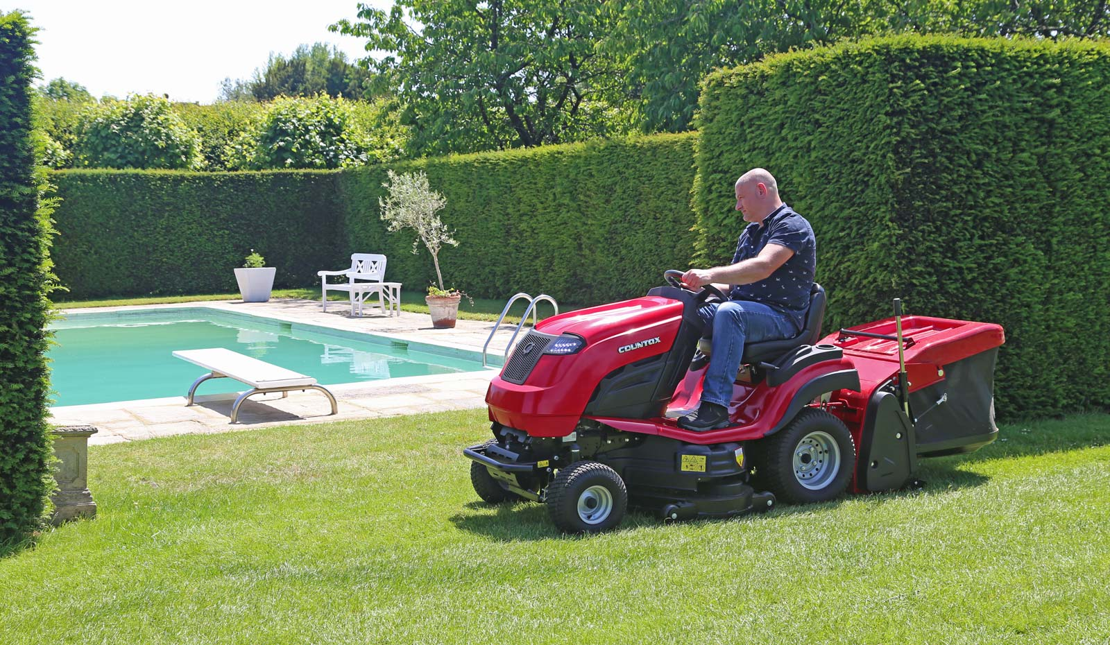 Countax C Series C80 garden tractor mower mowing by swimming pool