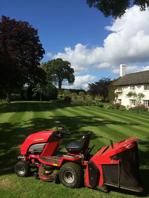 Countax garden tractor on striped lawn in front of house