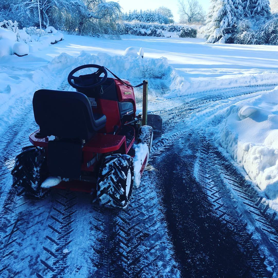 Countax garden tractor removing snow with snow blade
