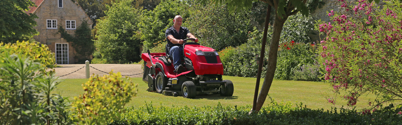 Countax C Series lawn garden tractor ride on mower cutting and collecting grass with PGC+