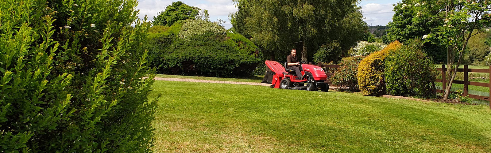 Countax C Series lawn garden tractor mower cutting and collecting grass with Powered Grass Collector